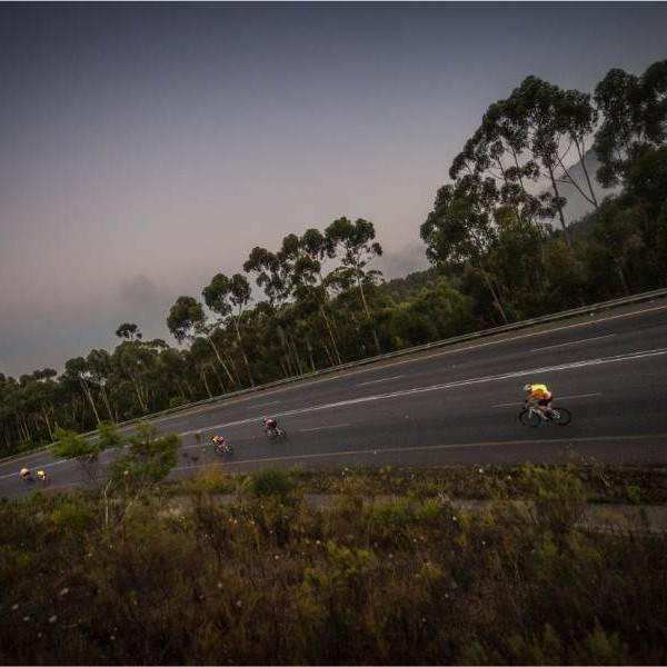 Cyclist at night on Cape Rouleur